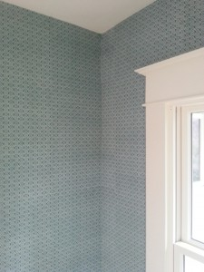 Beautiful blue and white wallpaper pattern meets in a corner