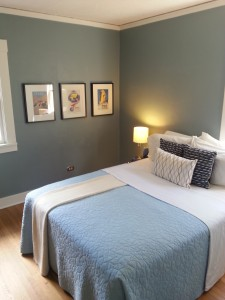 Soothing blue paint upgrades this comfortable Portland, Oregon bedroom