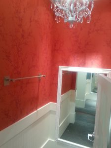 Professional red floral pattern wallpaper hung in Portland, Oregon