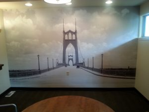 Dining nook with photograph wallpaper hanging