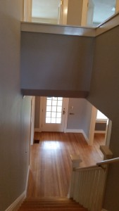 Painted stairway (walls, ceiling, trim, banister,doors) as viewed from landing