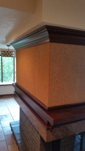 Grass wallpaper on fireplace installed by Blue SKY PDX in Portland, oregon