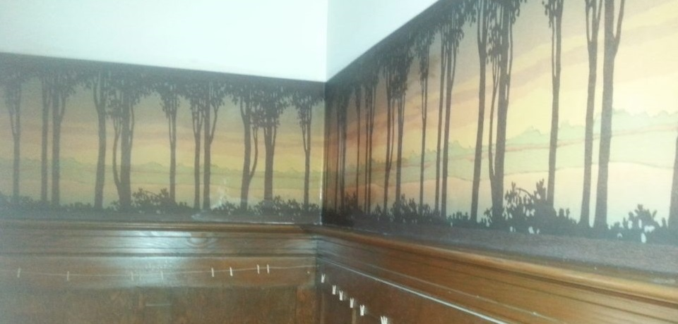 Wallpaper border above wainscoting in old-style Portland house